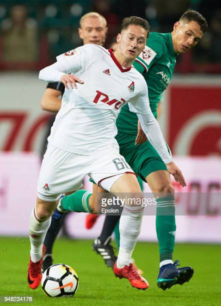 Anton Miranchuk of Lokomotiv Moscow vies for the ball with Anton Shvets of FC Akhmat Grozny during the Russian Premier League match between FC...