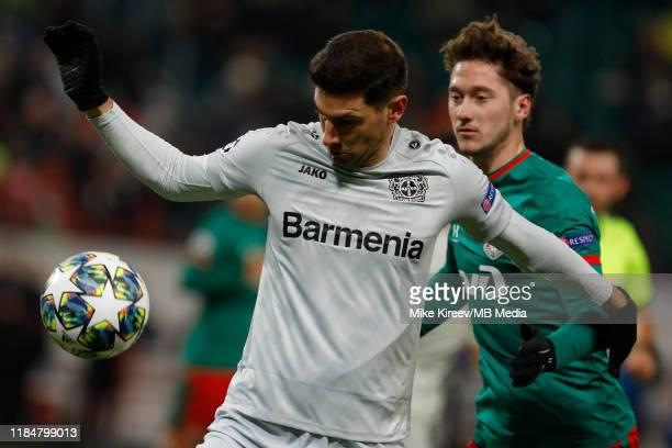 Anton Miranchuk of Lokomotiv Moskva and Lucas Alario of Leverkusen vie for the ball during the UEFA Champions League group D match between Lokomotiv...