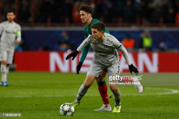 Anton Miranchuk of Lokomotiv Moskva and Panagiotis Retsos of Leverkusen vie for the ball during the UEFA Champions League group D match between...