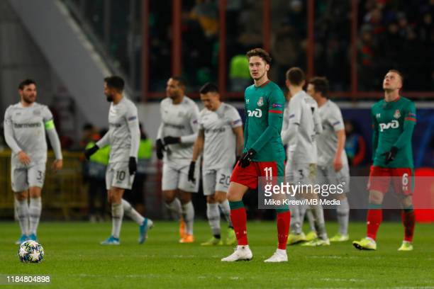 Anton Miranchuk of Lokomotiv Moskva looks on as Leverkusen players celebrate a goal in background during the UEFA Champions League group D match...