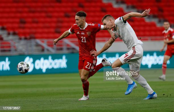 Anton Miranchuk of Russia fights for the ball with Attila Szalai of Hungary during the UEFA Nations League group stage match between Hungary and...
