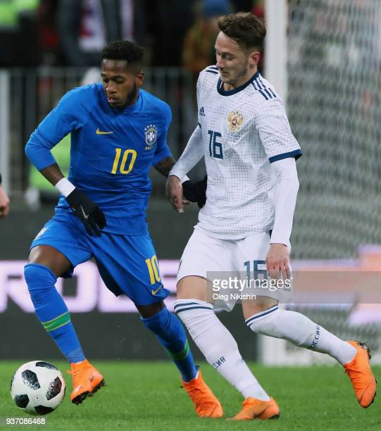 Anton Miranchuk of Russia vies for the ball with Fred of Brazil during the International friendly match between Russia and Brazil at Luzhniki Stadium...
