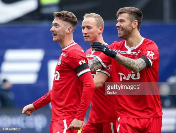 Anton Miranchuk , Vladislav Ignatyev and Fyodor Smolov of FC Lokomotiv Moscow celebrate after scoring a goal during the Russian Premier League match...