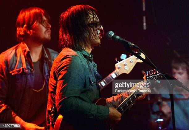 Anton Newcombe of The Brian Jonestown Massacre performs on stage at the East Village Arts Club on July 12 2014 in Liverpool United Kingdom