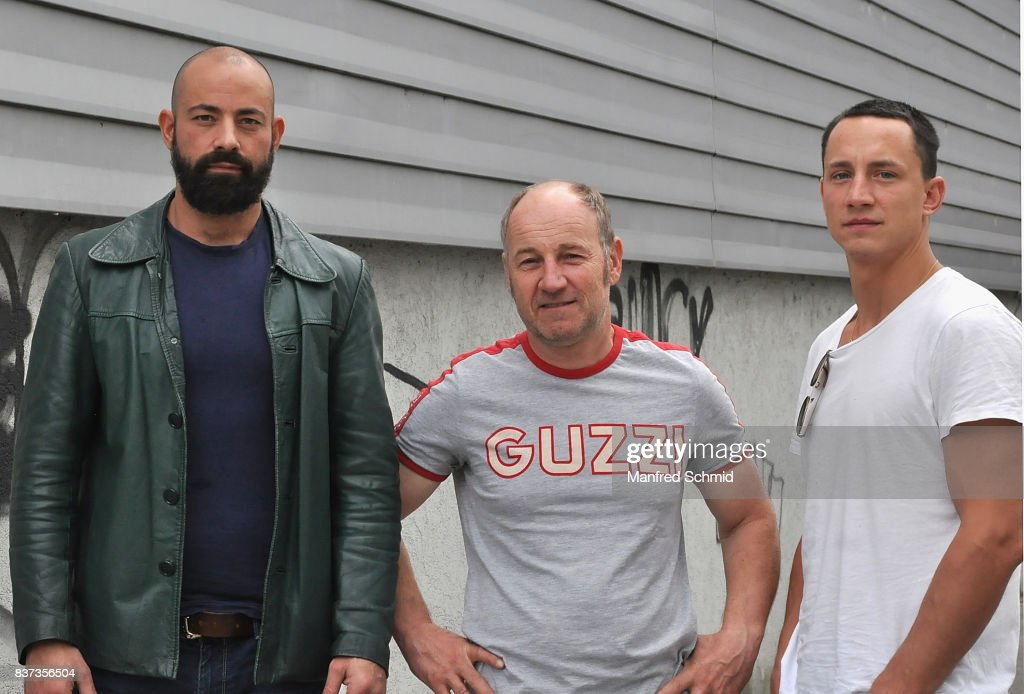 Anton Noori, Roland Dueringer and Laurence Rupp pose during a set visit for 'Cops' at Dusika Stadion on August 22, 2017 in Vienna, Austria.
