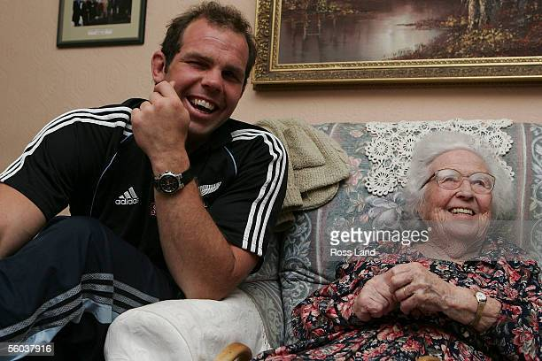 Anton Oliver of the All BAlcks meets 95 year old Enid Williams during a visit to Enid's home October 31 2005 in Cardiff Wales Enid's father was...