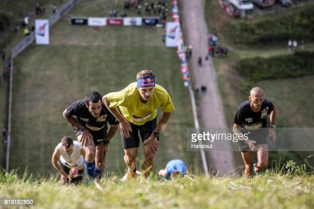 Anton Palzer of Germany leads Johan Goubau of Belgium and Matjaz Miklosa of Slovenia up the 400 metre skijump at Hochfirstschanze during the final of...