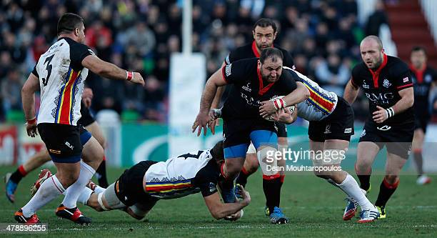 Anton Peikrishvili of Georgia is tackled by Mihai Macovei of Romania during the FIRAAER European Nations Cup Division 1A match between Georgia and...