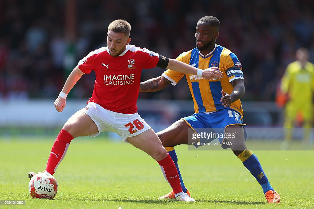 Anton Rodgers of Swindon Town and Abu Ogogo of Shrewsbury Town compete during the Sky Bet League One match between Swindon Town and Shrewsbury Town at County Ground on May 8, 2016 in Swindon, England.