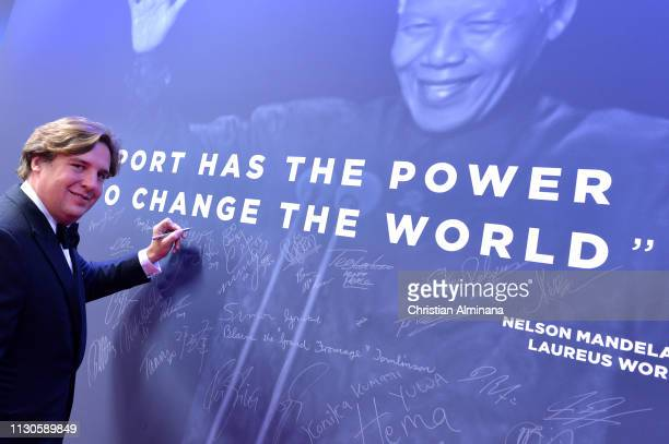 Anton Rupert Jr signs the Nelson Mandela wall during the 2019 Laureus World Sports Awards on February 18 2019 in Monaco Monaco