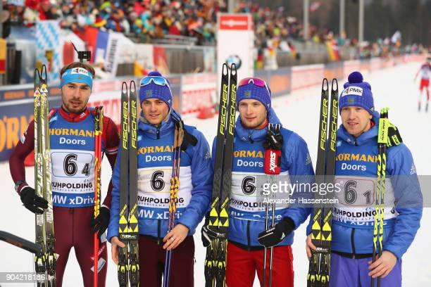 Anton Shipulin Anton Babikov Maxim Tsvetkov and Alexey Volkov of Russia celebrate winning the 3rd place at the men's 75km relay competition during...