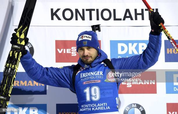 Anton Shipulin of Russia celebrates on podium winning the men's 10km sprint event at the IBU Biathlon World Cup in Kontiolahti Finland on March 8...