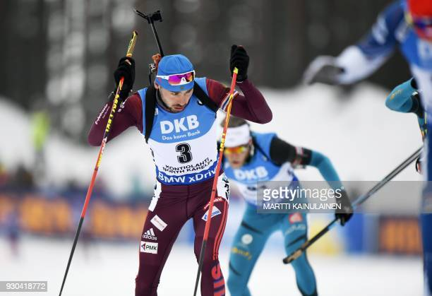 Anton Shipulin of Russia competes in the men's 15km mass start event at the IBU Biathlon World Cup in Kontiolahti Finland on March 11 2018 / AFP...
