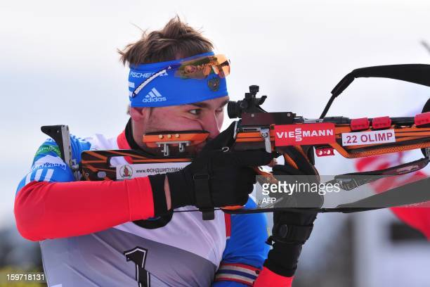 Anton Shipulin of Russia competes to win the 125 kilometers' pursuit race of the men's biathlon World Cup race in victory on January 19 2013 in...