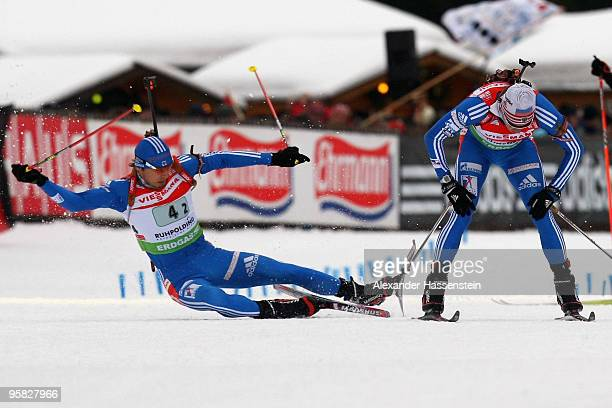 Anton Shipulin of Russia crashes during the handover by his team mate Ivan Tcherezov during the Men's 4 x 75km Relay in the eon Ruhrgas IBU Biathlon...
