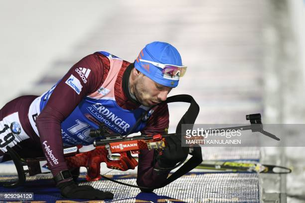 Anton Shipulin of Russia performs at the shooting range during the men's 10km sprint event at the IBU Biathlon World Cup in Kontiolahti Finland on...