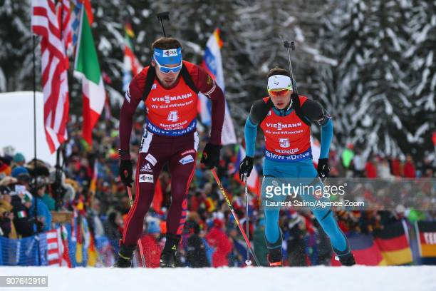 Anton Shipulin of Russia takes 3rd place Simon Desthieux of France competes during the IBU Biathlon World Cup Men's and Women's Pursuit on January 20...
