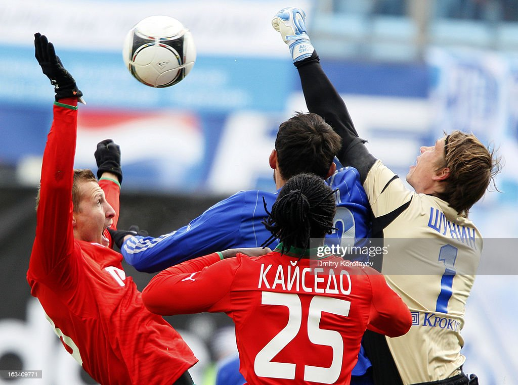 Anton Shunin (R) of FC Dynamo Moscow is challenged by Jan Durica and Felipe Caicedo of FC Lokomotiv Moscow during the Russian Premier League match between FC Dynamo Moscow and FC Lokomotiv Moscow at the Arena Khimki Stadium on March 09, 2013 in Khimki, Russia.