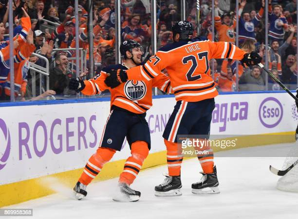 Anton Slepyshev and Milan Lucic of the Edmonton Oilers celebrate after a goal during the game against the New Jersey Devils on November 3 2017 at...