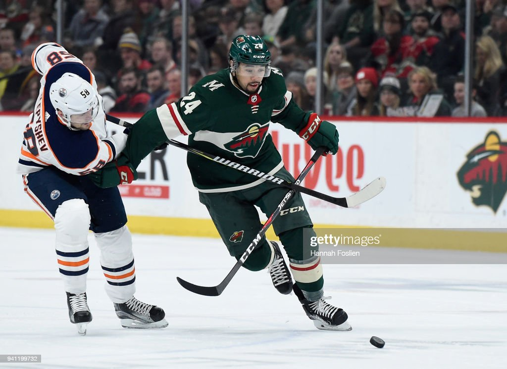 Anton Slepyshev #58 of the Edmonton Oilers and Matt Dumba #24 of the Minnesota Wild skate after the puck during the first period of the game on April 2, 2018 at Xcel Energy Center in St Paul, Minnesota. The Wild defeated the Oilers 3-0.