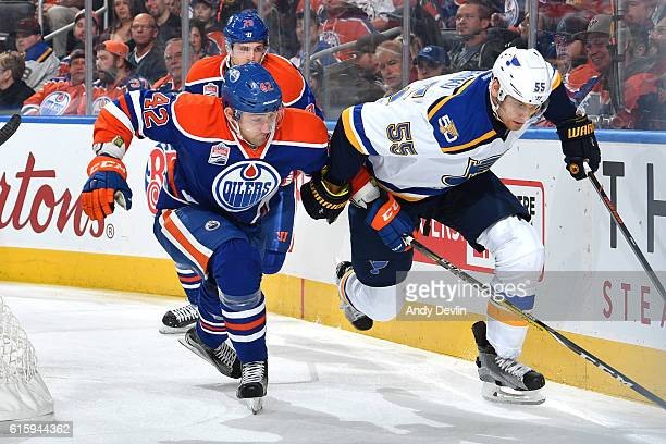 Anton Slepyshev of the Edmonton Oilers battles for the puck against Colton Parayko of the St Louis Blues on October 20 2016 at Rogers Place in...