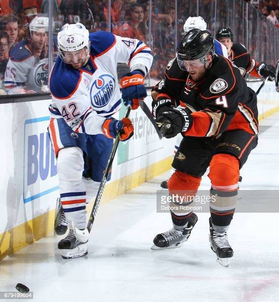 Anton Slepyshev of the Edmonton Oilers battles for the puck against Cam Fowler of the Anaheim Ducks in Game Five of the Western Conference Second...