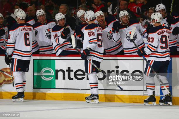 Anton Slepyshev of the Edmonton Oilers celebrates his second period goal with his team bench during the game against the New Jersey Devils at...