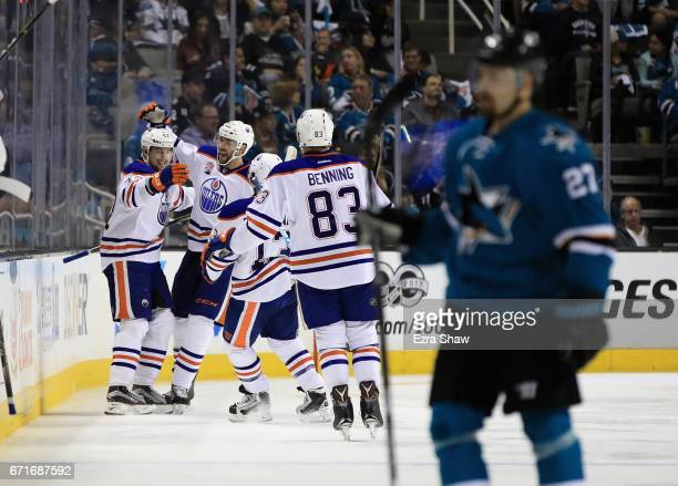 Anton Slepyshev of the Edmonton Oilers celebrates with teammates after he scored a goal in the second period against the San Jose Sharks in Game Six...