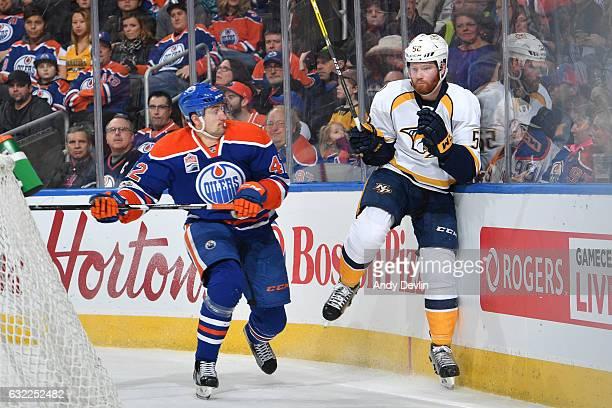 Anton Slepyshev of the Edmonton Oilers checks Matt Irwin of the Nashville Predators on January 20 2017 at Rogers Place in Edmonton Alberta Canada