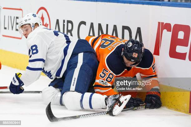 Anton Slepyshev of the Edmonton Oilers collides with Connor Brown of the Toronto Maple Leafs at Rogers Place on November 30 2017 in Edmonton Canada