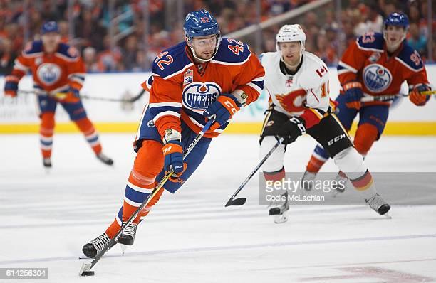 Anton Slepyshev of the Edmonton Oilers is pursued by Kris Versteeg of the Calgary Flames on October 12 2016 at Rogers Place in Edmonton Alberta Canada