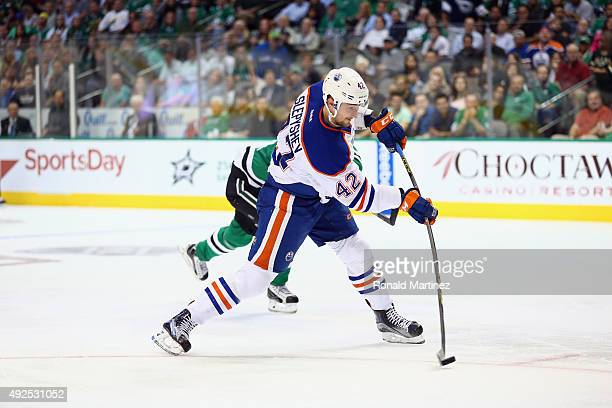 Anton Slepyshev of the Edmonton Oilers takes a shot against the Dallas Stars in the second period at American Airlines Center on October 13 2015 in...