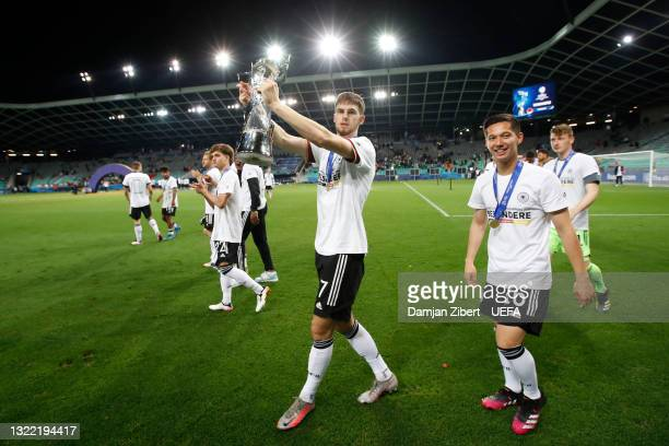 Anton Stach of Germany celebrates with the UEFA European Under-21 Championship trophy following victory in the 2021 UEFA European Under-21...