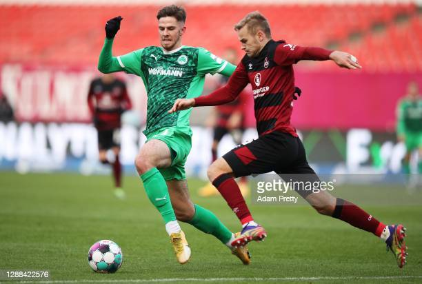 Anton Stach of SpVgg Greuther Fuerth is challenged by Tim Handwerker of 1. FC Nuernberg during the Second Bundesliga match between 1. FC Nürnberg and...