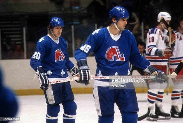 Anton Stastny and brother/teammate Peter Stastny of the Quebec Nordiques skate on the ice during an NHL game against the New York Rangers on March 22...