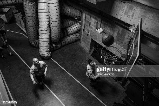 Anton Stralman and Louis Domingue of the Tampa Bay Lightning play basketball during the pregame warm ups against the Boston Bruins during Game Five...