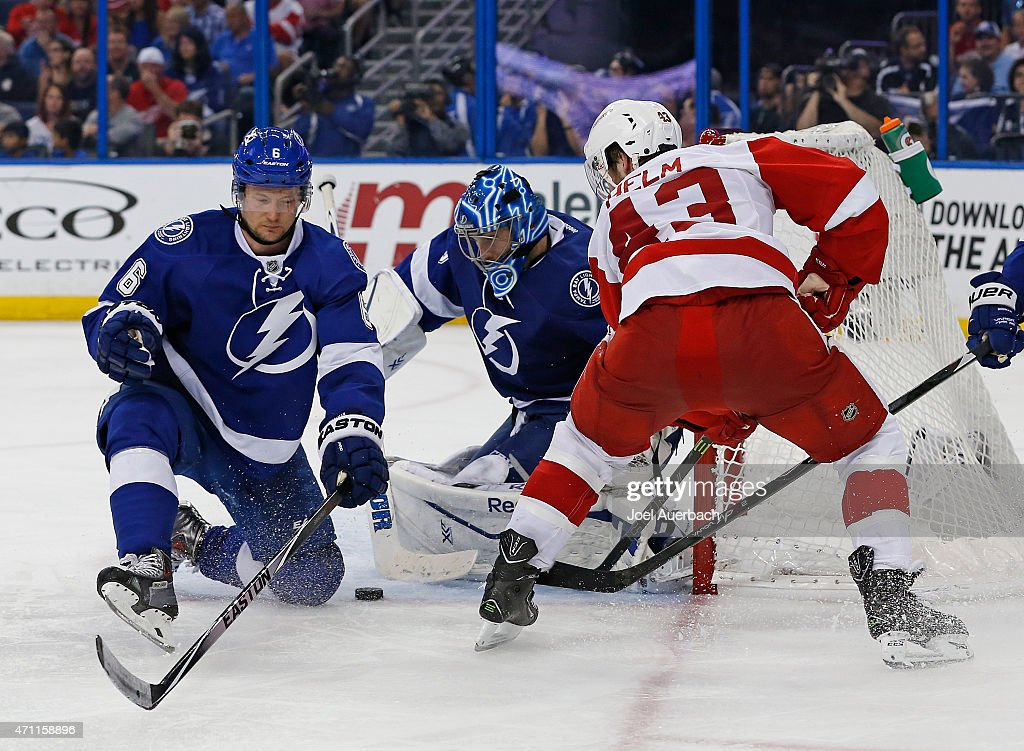 Anton Stralman #6 assists Goaltender Ben Bishop #30 of the Tampa Bay Lightning defends the net against the shot by Darren Helm #43 of the Detroit Red Wings during the third period in Game Five of the Eastern Conference Quarterfinals during the 2015 NHL Stanley Cup Playoffs at the Amalie Arena on April 25, 2015 in Tampa, Florida. The Red Wings defeated the Lightning 4-0.