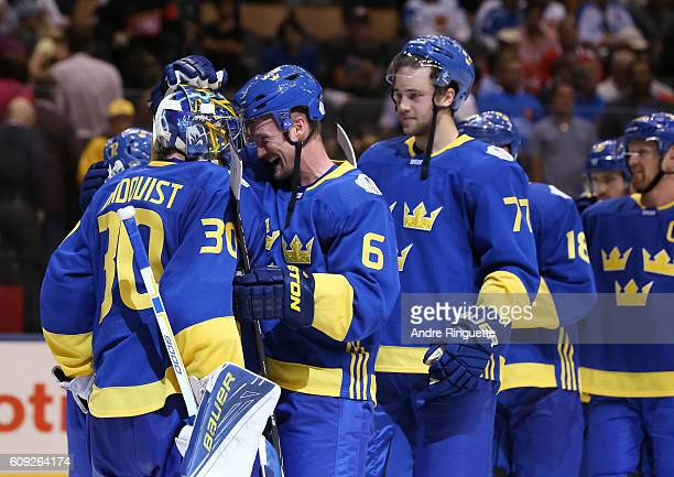 Anton Stralman congratulates Henrik Lundqvist of Team Sweden after a 20 shutout win over Team Finland during the World Cup of Hockey 2016 at Air...