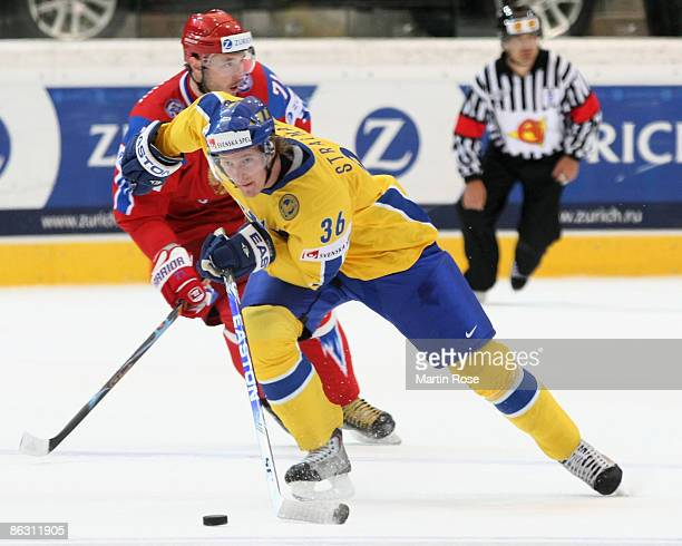 Anton Stralman of Sweden skates with the puck during the IIHF World Ice Hockey Championship qualification round match between Russia and Sweden at...
