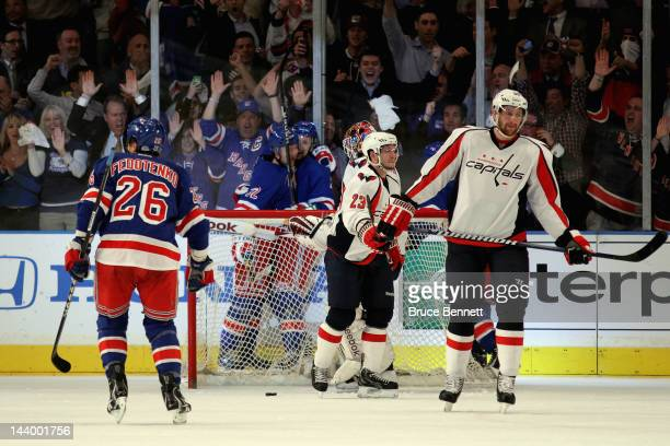 Anton Stralman of the New York Rangers celebrates with teammate Derek Stepan after scoring a goal in the first period against Braden Holtby of the...