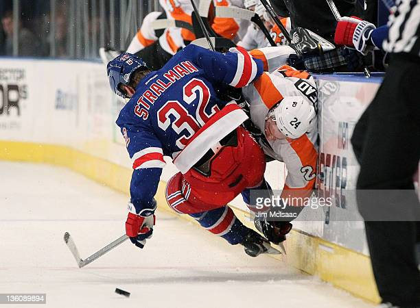 Anton Stralman of the New York Rangers lands a check against Matt Read of the Philadelphia Flyers during the first period on December 23 2011 at...