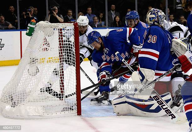 Anton Stralman of the New York Rangers sweeps the puck away from the goalline and Marian Gaborik of the Los Angeles Kings during the first period of...