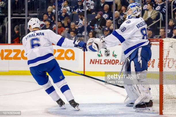 Anton Stralman of the Tampa Bay Lightning celebrates with goaltender Andrei Vasilevskiy after a first period goal against the Winnipeg Jets at the...