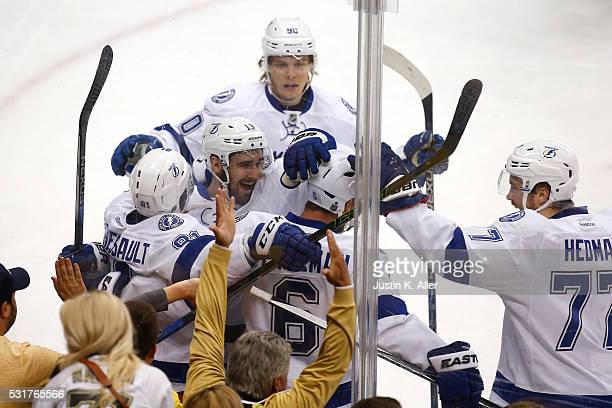 Anton Stralman of the Tampa Bay Lightning celebrates with his teammates after scoring a goal against Matt Murray of the Pittsburgh Penguins during...
