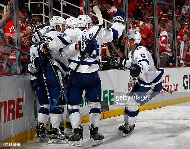 Anton Stralman of the Tampa Bay Lightning celebrates with teammates after a game winning overtime goal by Tyler Johnson to beat the Detroit Red Wings...