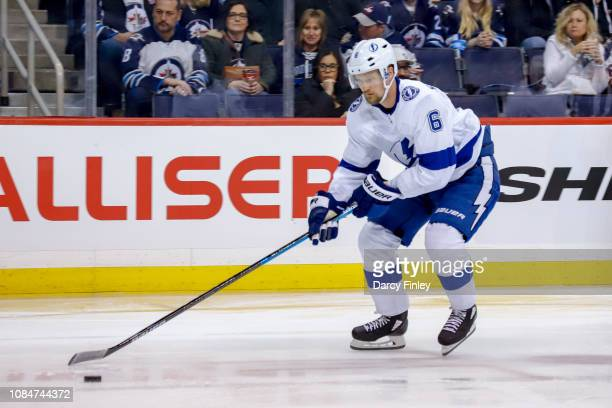 Anton Stralman of the Tampa Bay Lightning plays the puck down the ice during second period action against the Winnipeg Jets at the Bell MTS Place on...