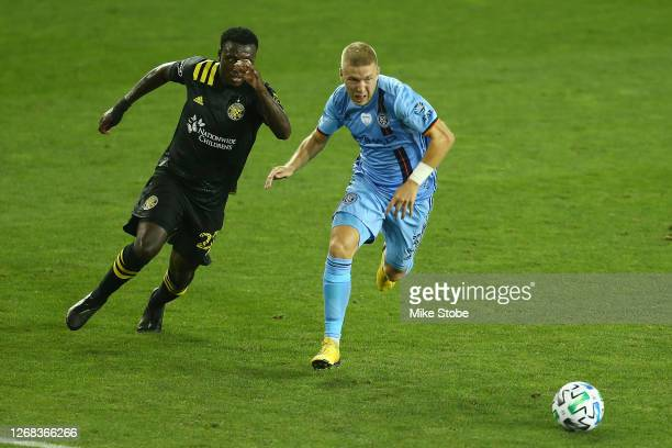 Anton Tinnerholm of New York City and Derrick Etienne of Columbus Crew pursue the ball at Red Bull Arena on August 24, 2020 in Harrison, New Jersey.