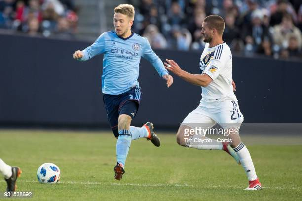 Anton Tinnerholm of New York City challenged by Perry Kitchen of Los Angeles Galaxy during the New York City FC Vs LA Galaxy regular season MLS game...