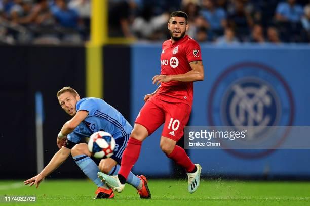 Anton Tinnerholm of New York City FC falls to the ground as Alejandro Pozuelo of Toronto FC takes control of the ball at Yankee Stadium on September...
