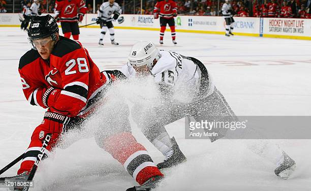 Anton Volchenkov of the New Jersey Devils and Brad Richardson of the Los  Angeles Kings battle c61f8b647